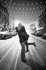 New Years Engagement 1 (karlwpfeiffer) Tags: christmas street city eve wedding snow love bar night lights evening engagement kiss colorado downtown candles day wine couples denver romantic newyears cru classy larimerstreet karlpfeiffer