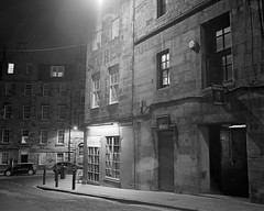 Candlemaker row (steveo_mcg) Tags: bw white black film bar night dark 50mm edinburgh flood oz row neopan 100 lit stores rodinal later acros rb67 candlemaker