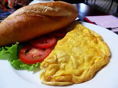 Vietnamese breakfast (Roving I) Tags: travel tourism tomatoes egg lifestyle vietnam baguette dining omelette danang breadrolls lettucs madamelan