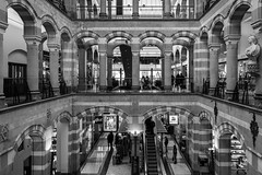Magna Plaza (McQuaide Photography) Tags: amsterdam noordholland northholland netherlands nederland holland dutch europe sony a7ii ilce7m2 alpha mirrorless 1635mm sonyzeiss zeiss variotessar fullframe mcquaidephotography adobe lightroom photoshop handheld stad city urban architecture capitalcity capital old museum wideangle wideanglelens groothoek history historic geschiedenis interior indoor inside ornate detailed complex shape form geometry light shade shadow arch curve magnaplaza shopping shoppingmall shoppingcentre winkelcentrum arcade mall monumentalbuilding rijksmonument nationalmonument blackandwhite bw mono monochrome