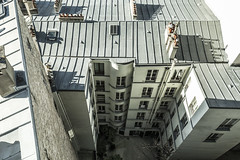 Parisian Courtyard (Remy Carteret) Tags: canon 5d mkii mk2 markii france eos remycarteret rémycarteret color rooftops roof parisrooftops canon5dmarkii canon5dmark2 canoneos5dmarkii canoneos5dmark2 5dmark2 5dmarkii mark2 canon5d paris toit toits toitsdeparis toitsparis toiture toitureparis toitures cheminée chimney chimneys courtyard cours parisiancourtyard rooftopsparis roofs roofsparis roofertop roofing windows window fenêtre fenêtres