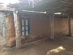 Teak and mud walls, clay tile and thatch roof