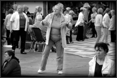 Strutting her stuff (* RICHARD M) Tags: street fun mono blackwhite dancing candid dancer fundraising fundraiser southport seniors merseyside sefton inthezone lordstreet struttingherstuff townhallgardensouthport