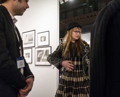 Last Shot from the AIPAD Show (UrbanphotoZ) Tags: nyc newyorkcity woman ny newyork man wool hat dress manhattan tag rings photographs eastside leatherjacket pleated motorcyclejacket aipad parkavenuearmory associationofinternationalphotographyartdealers