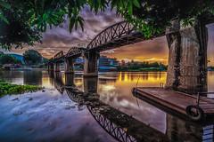 Bridge at Sunrise (mcalma68) Tags: thailand bridge river kwai sunrise longexposure waterfront cityscape clouds reflections