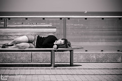 Taking a nap (Streetix) Tags: shorts sea streetlife candid belgium goodlife asleep duotone streetphotography blackandwhite locaties koksijde zee creatief street nap woman chilling peacefull nikon monochrome girl