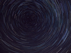 Spinning around on a little blue ball (caleb.lee) Tags: star startrails sky alberta canada northstar