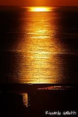 L'ora d'oro Porto Azzurro Sunshine (Riccardo Galletti ~ Isola d'Elba) Tags: light sunset sea sun beach sunrise gold elba mare sole luce oro isoladelba portoazzurro visitelba
