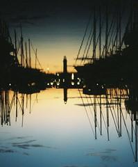 The sky as a mirror. (Leonor F) Tags: symmetry water sunset blue yellow sea port ship silhouette contrast analog analogue film filmisnotdead filmphotography melancholy yashica kodak portra 400 summer reflection upsidedown upside down