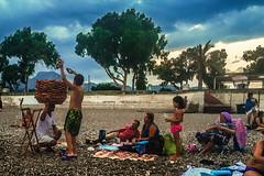 Time for simit (Melissa Maples) Tags: konyaaltbeach beach antalya turkey trkiye asia  apple iphone iphone6 cameraphone family summer simit food turk man vendor simiti