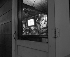 Back Door to the Buckhorn - Petaluma, CA (Rex Mandel) Tags: petalumaca bar divebar blackandwhite bw night noir screendoor backdoor petaluma door monochrome