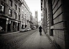 Old Montreal in B&W (` Toshio ') Tags: toshio montreal canada notredamedemontreal notredamebasilica church oldtown oldmontreal blackandwhite bw man walking street cobblestone city architecture fujixe2 xe2 road cityscape canadian