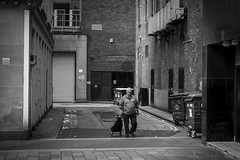 Visit Glasgow (Leanne Boulton) Tags: monochrome alley alleyway architecture urban street candid portrait streetphotography candidstreetphotography streetlife negativespace isolation urbanlandscape man male face facial expression shopping trolley walking local emptiness grit grime tone texture detail posture depth natural outdoor light shade shadow city scene human life living humanity people society culture canon 7d 50mm black white blackwhite bw mono blackandwhite glasgow scotland uk