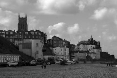Cromer (Ashley Middleton) Tags: sky people white black building beach church monochrome stone clouds buildings grey sand stones cromer greyscale
