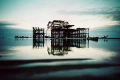 old lady of brighton (a.k.a. the pier-bot) (fotobes) Tags: sea sky reflection wet water clouds reflect