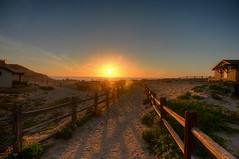 Follow the Light (KC Mike D.) Tags: wood fence railing sunset ocean pacifiic water sea sand dunes shadow light sunrays monterey bay montereybay california