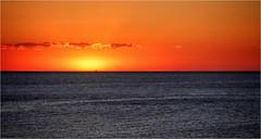 Orange and blue. (Ova.) Tags: puestadesol sunset coloniadelsacramento uruguay canon 6d cielo rio orange riodelaplata