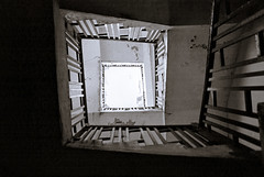 Staircase in abandon building (FotoGrazio) Tags: freetodownload composition decay rails fotograzio digitalphotography capture contrast waynegrazio splittone spiral artofphotography freeimage rail building art downloadforfree photoshoot staircase flickr worldphotographer sandiegophotographer californiaphotographer photographersinsandiego explore upward old freepicture waynesgrazio internationalphotographers 500px stairs photographersincalifornia photographicart blackandwhite photography architecture