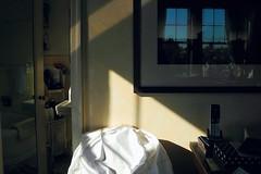 white shirt (omoo) Tags: windows sunlight art glass reflections bathroom apartment interior antiques lowermanhattan whiteshirt framedphotograph yellowbath dscn7043 mirroredbathroomdoor aboveabingdonsquare