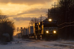 A Colorful Sunset, Blowing Snow, And A Train (Nolan Majcher) Tags: