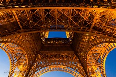 Human Ingenuity (Gioia & Andrea) Tags: blue sky orange paris france tower architecture night iron tour geometry eiffel symmetry middle ingenuity