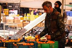 Citrus seller (Ri0na) Tags: street people italy orange man rome fruits lemon italian europe market cigarette streetphotography seller