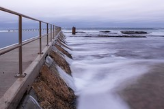 Spill Over (ImagesByLin) Tags: ocean longexposure sea pool clouds dawn cloudy spillover oceanbaths merewetherbaths