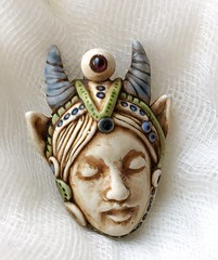 face pendant with spiral horns (SelenaAnne) Tags: polymerclay polyclay sculpey cernit fimo handmade bead