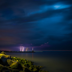 Stormy Weather (iPhilFlash) Tags: water longexposure vancouver sky outdoors britishcolumbia garrypointpark cloud twilight lightning richmond outdoor canada fraserriver steveston clouds storm blue