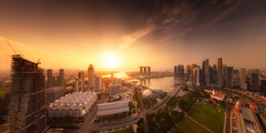 Atmospheric (Scintt) Tags: singapore marina bay sunrise sun sky clouds early morning dramatic surreal pano panorama stitched buildings architecture cityscape city skyline vantage point tall height offices financial business commerce travel glow light golden sunny raffles place hall tanjong pagar shenton way mbs hotel exclusive mall shopping luxury radiant jon chiang photography urban modern futuristic scintillation scintt downtown suntec esplanade victoria concert parliament house iconic landmarks dawn