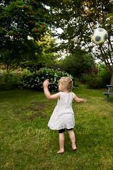 Throw (LongInt57) Tags: girl child children playing throwing ball soccer football yard garden lawn grass trees bushes flowers kelowna bc canada okanagan white green motion blur