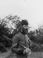 Half-length portrait of man in military uniform, to left, with beard and moustache, wearing three stripes on his sleeve, with a rifle insignia, holding a swagger stick (State Library Victoria Collections) Tags: 1920s 1930s sticks 1910s 1930 statelibraryofvictoria statelibraryvictoria sticksandstones