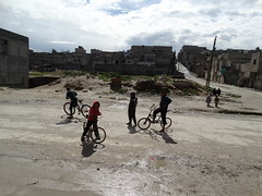 Bikers in Aleppo (Ummah Welfare Trust) Tags: poverty winter children war refugee islam arabic east relief hunger arab middle shaam humanitarian aleppo displaced humanitarianism ummah idlib