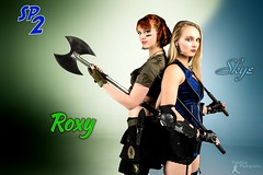 SP2: Roxy and Skye (FightGuy Photography) Tags: gorgeous longhair knife skirt redhead gloves armor pistol blonde shorthair shorts weapons studioa battleaxe studiophotography womenwithweapons suckerpunched union206