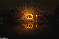 Steel / Wire wool spinning over water (Rick Drew - 15 million views!) Tags: bridge orange hot reflection wool water night dark circle evening wire melting glow spiders steel spinning heat swirl sparks bounce riccochet