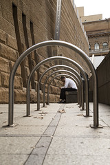being put through the hoops (Salle-Ann) Tags: street urban man sydney streetphotography