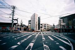 intersectional (troutfactory) Tags: film lines japan grid vanishingpoint perspective wideangle powerlines  osaka intersection analogue crosswalk kansai  toyonaka parallellines 15mmheliar voigtlanderbessal   kodakektar100
