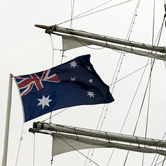 Flag of Australia against the background of the system of ropes and  sails (zivko.trikic) Tags: flag cruise mode australianautical deck cloud travel day ropes sign culture symbol yachting ship old obsolete yacht woods traditional rigger masts rigging equipment transport tall sailboat up high blue outdoors transportation backgrounds sky boat antique sea sail part angle water journey vessel