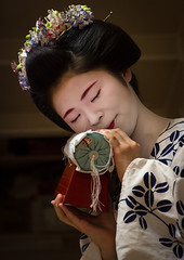 16 Years old maiko called chikasaya with the pillow shes used to protect her hairstyle, Kansai region, Kyoto, Japan (Eric Lafforgue) Tags: wood red woman white beautiful beauty face japan vertical closeup female hair asian japanese clothing eyes kyoto colorful asia pretty feminine candid painted young culture makeup grace pillow indoors teen maiko geisha teenager kimono gion tradition oriental youngadult solitary hairstyle youngwoman apprentice oneperson headwear hairbun elaborate kanzashi 1617years oneyoungwomanonly 1people kansairegion japaneseethnicity colourpicture japan161925 chikasaya komayaokiya