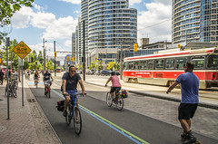 Queen's Quay after Streetscape Redesign (fotofrysk) Tags: toronto ontario canada cyclists harbour harbourfront skater condos lakeontario streetscape torontoislands queensquay 5553 nikond7100 streetredesign