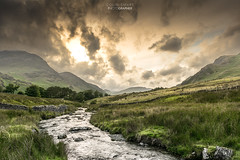 End of day lighting. (DigitalAutomotive) Tags: the lake district july 2016 buttermere cumbria crummock water stormy day wet weather clouds green trees tree line fence vista view lakes england english tourism visit visiting outdoor cloud sky hill landscape mountainside sunset fire evening visitcumbria watercourse