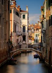 Streets of Venice (ludwigriml) Tags: bridges canal longexposurephotography ludwigrilmlphotography ludwigrimlnaturallightphotography naturallightphotography rivadeglischiavoni town venezia venice water balconies boat chimneys houses