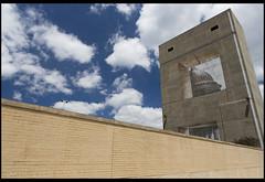 Through the Concrete Window (Nrbelex) Tags: canon dslr 5dmkiii nrbelex ef2470mm 2470mmf28 2470mm 2470mml 5diii washington dc washingtondc bw polarizer bwcircularpolarizer circularpolarizer wall sky clouds street concrete mural argb adobergb