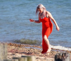 Lady in Red (ian con) Tags: girls blondes beach sea coast red dress legs glamour