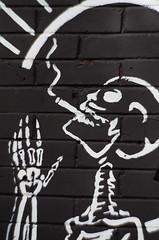 Praying (LornaTaylor) Tags: 85mm copyright2016lornataylor lornataylor lornataylorphotography taylorimagesca photowalk shutterbugs nikon skeleton smoking death prayer petzval