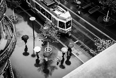 Rainy Day#13&5 (DonStevie) Tags: street leica city shadow people blackandwhite bw wet water rain umbrella 50mm switzerland blackwhite rainyday candid zurich tracks streetphotography tram trains stranger summicron commute shadowplay 50 umbrellas raining trams streetshooting 50mmsummicron 50mmf2summicron streetphotog leicammonochrom leicamonochromlove rainyday135 andrékertészinspired