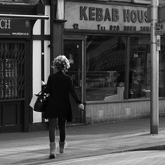 Curlers and Kebabs (_steve h_) Tags: urban blackandwhite bw woman house london hair walking square candid sony streetphotography hairdo kebab kebabs curlers nex6