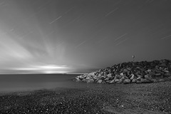 Folkestone - 25 Minute Black And White Long Exposure - Star Trails (Ben O'Reilly) Tags: ocean longexposure blue light sea sky blackandwhite orange mist colour beach monochrome beautiful clouds stars landscape photography timelapse seaside haze rocks long exposure flickr time bell cloudy outdoor tide explore shore ghosts hazy astral lapse