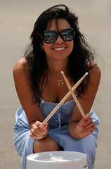 Pretty Drummer (Poocher7(Gone to the trailer)) Tags: people drummer drums whitebucket drumsticks prettydrummer prettygirl tanned bluesummerdress bluedress sundress pretty cute lovely smile participation fun pinkfingernails crouched candid portrait outdoors learning