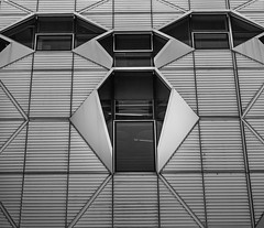 Face in the city (Martyn.A.Smith) Tags: abstract building angles architecture blackwhite daytime fujifilm face glass lines monochrome metalwork outdoors shapes university windows coventry warwickshire englanduk xti